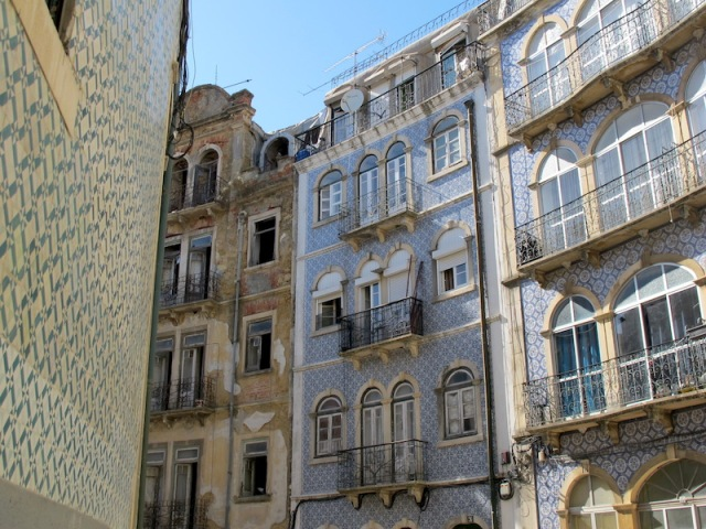 Three tiled apartments buildings.
