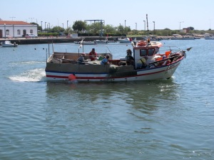 Fishing boat with a list to starboard going off to work