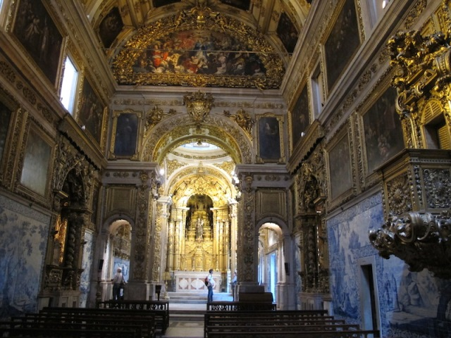 The interior of the convent's church. Religious tile scenes line the walls.