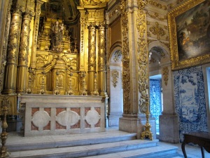 The altar is decorated with gold leaf, not gold paint.