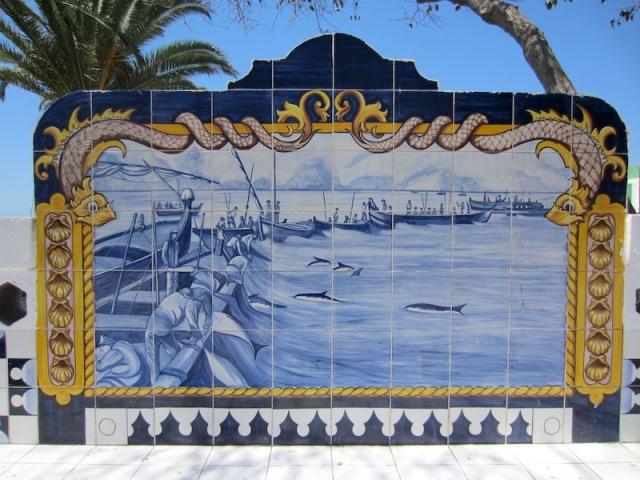 Seat backdrop depicting fishing scenes in the region.