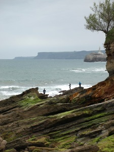 Sandstone uplifts along the coast to the west.