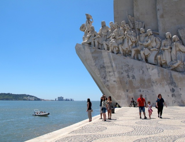 Portside of the Discoveries Monument. The figures are standing on a pedestal representing a ship's bow.