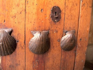 Scallop shell symbols on an old door.