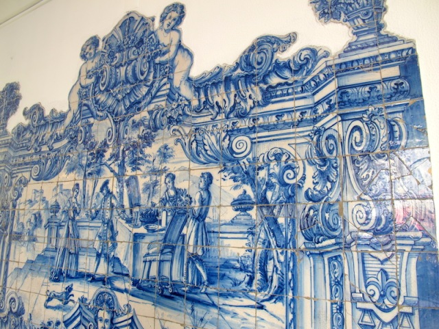 Portion of an old tile mural on the exterior wall of a café.