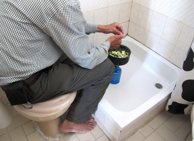 Preparing a meal in the shower recess.