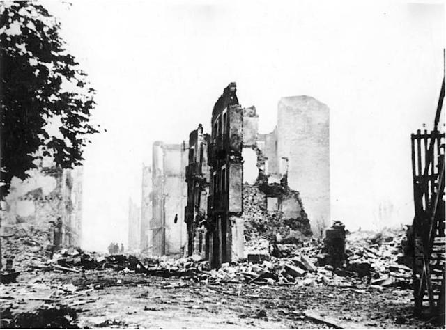 Guernica in ruins. Image free of copyright via Wikipedia.