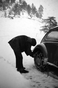 Putting on snow chains.