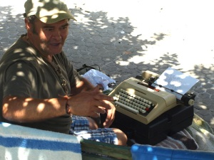 Our mystery man and his typewriter.