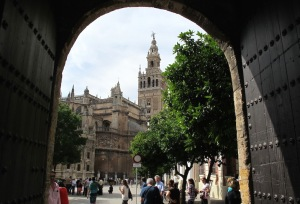 Looking out the exit gate of the Alcazar towards Seville's cathedral.