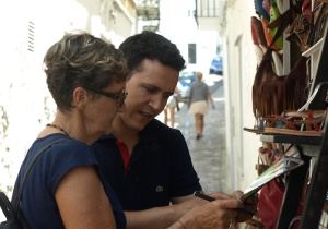 Bev getting the 'drum' as to where to go in Tangiers Morocco.  The friendly owner is a native of Morocco.