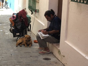 Doing the crossword in the backstreets of Tarifa.  This gentleman has the hallmarks of being homeless but he might just be a traveller who has accumulated too much stuff.