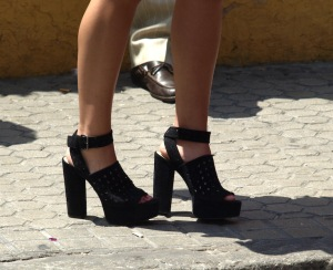 A pair of high heels with substantial heels but just the same not good for the feet.