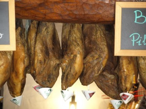 The legs of ham.  The paper cones are to catch any liquids dripping off the end of the hams into your beer!