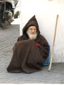 This man is wearing a traditional hooded woollen Berber cloak.  I had the feeling when I gave him a few coins he was not well.