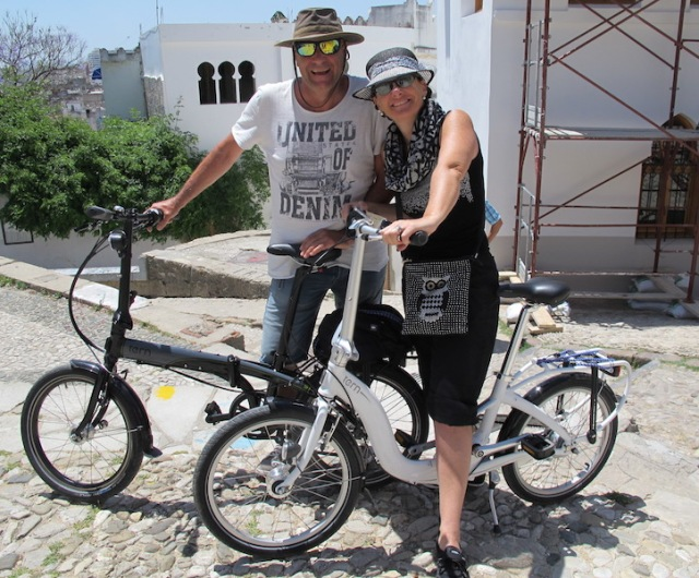 Harry and his wife on their bikes. The bikes they are riding are the same brand as ours. Note the rough cobblestone pavement.