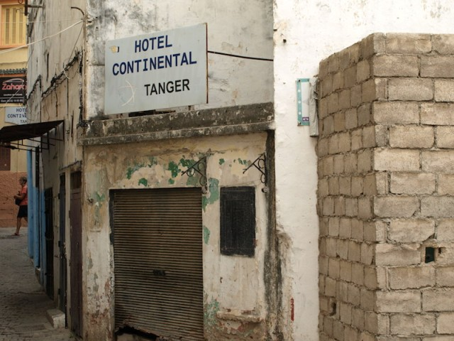 Sign along the alleyway leading to the Continental Hotel.