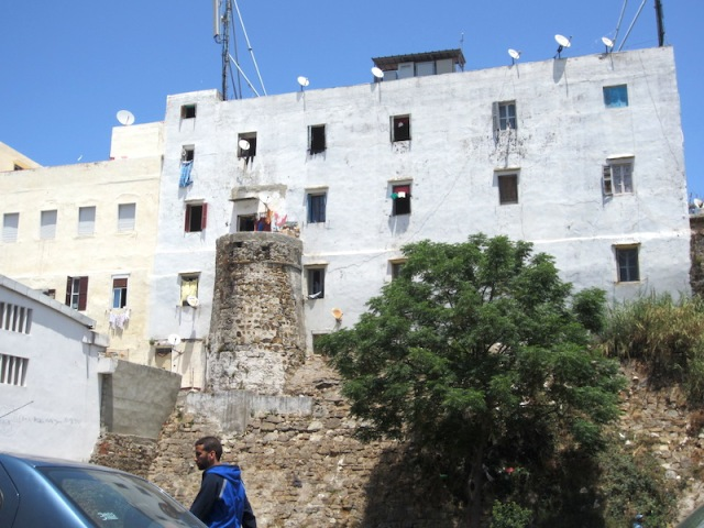 One of the newer apartments has cunningly utilised an old wall tower as a balcony.