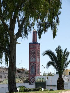 The principal centrepiece of the Grand Socco is the tiled Grand Mosque tower.