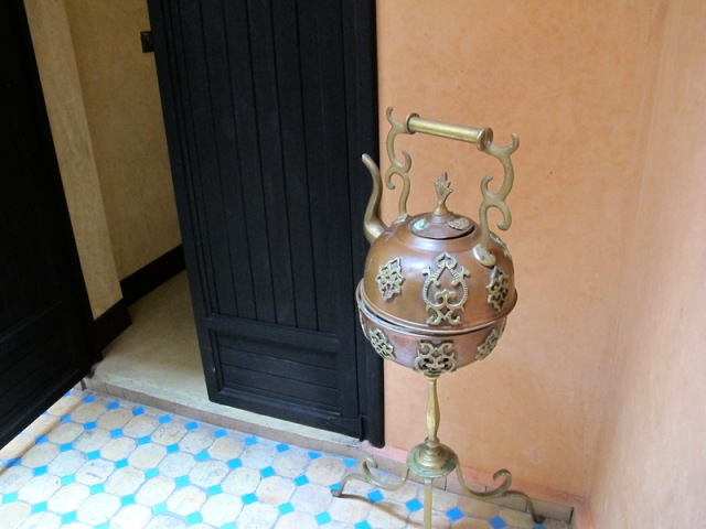 Ornate teapot pointing at our bedroom door.