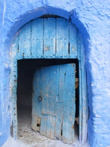 Ancient doorway. It is believed that the colour blue repels flies and mosquitoes. Maybe this is why the door is open.