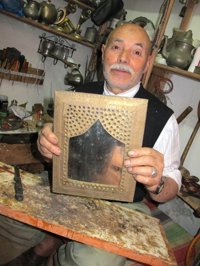 The creator of ornate frames. The mirror was not glass but polished stainless steel.