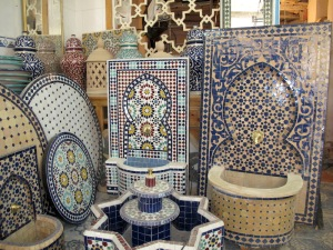 A showroom for tiled tabletops and water fountains.
