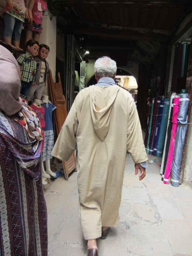 A rear view of a djellaba. Sometimes the hood is used as a pocket when in the down position, easy pickings for a pickpocket though.