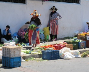 Berber women from the Rif Mountains in traditional clothing attending their vegetable stall.