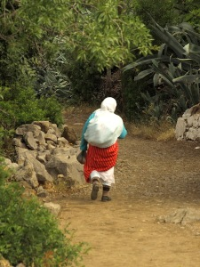 A Riffian women heading down to Chefchaouen.
