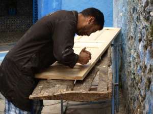 A carpenter making a door.