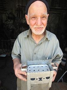 The tinsmith who made small charcoal burning stoves.