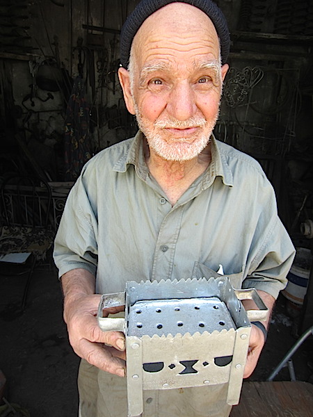 The tinsmith who made small charcoal burning stoves.