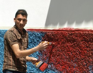 Blue to red.  Painting this wall was going to be a long job as the surface was rough necessitating a lot of dabbing Ali found my concertina book amusing.