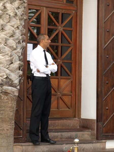 A doorman/security guard at Rick's Café.