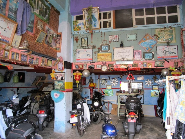 The interior of the motorcycle mechanic's workshop. Quite a menagerie really.