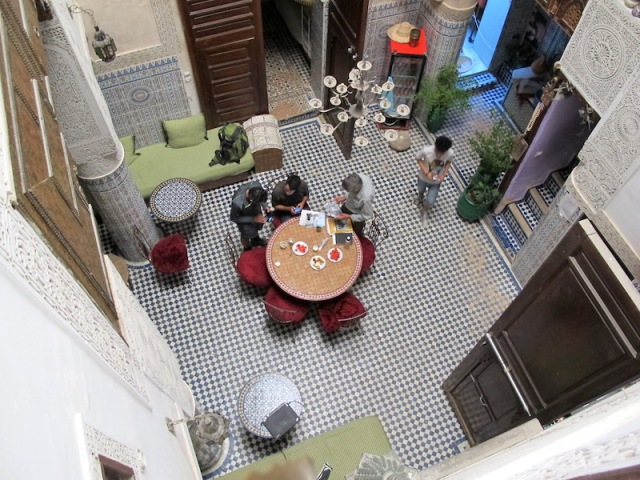 The atrium (courtyard) serving as a sitting/dining area of Dar Lalla Kenza. Talking travel with a couple of fellow travellers.