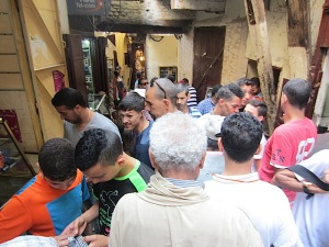 Moving into the mobile phone stalls of the market. The grey-haired man in the foreground is Abdul our guide