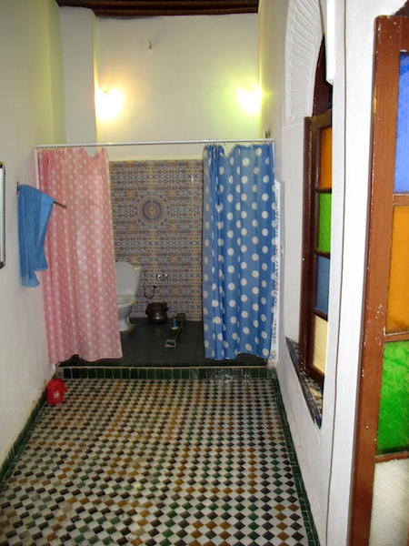 Our colourful ensuite bathroom. The spaciousness of the bathroom made one feel very regal.