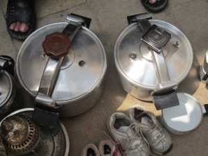 Pressure cookers along with other bits and bobs for sale in the Fez market.