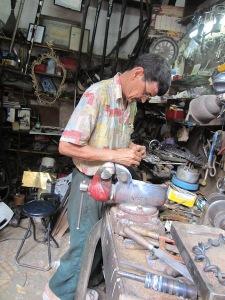 Mr Fixit the sewing machine repair man.
