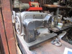 Sewing machines awaiting repair.