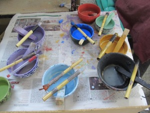 The glaze pots and brushes.