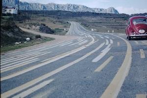 Confusing road markings in karst country Spain.
