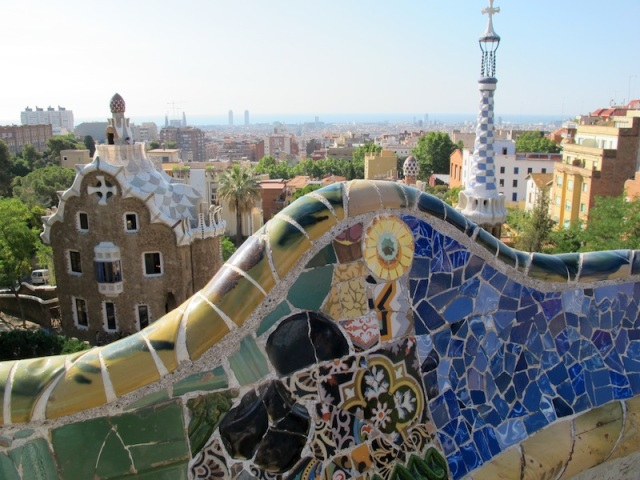 A wall and the view from above the Parc Guell Doric Temple.
