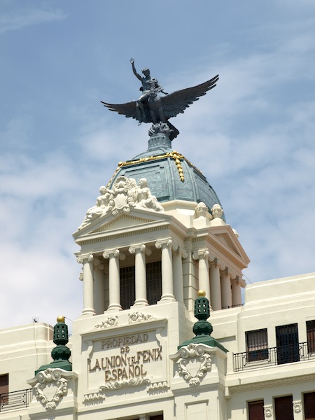 A bare-chested youth riding the Phoenix on top of the Union and Phoenix Insurance building
