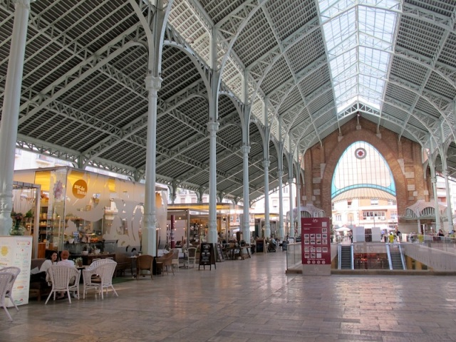 Cafes inside the markets. The construction is a credit to the manipulators of steel.
