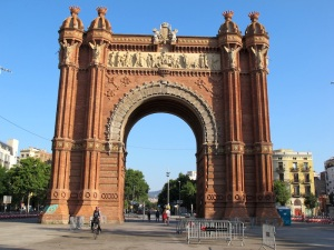Riding through Barcelona's Arc de Triomf. The photograph was taken early morning before the tourists hit the streets. The arch was built as the main entrance for the 1888 Barcelona World Fair.