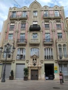 Creative false arch facade of a building somewhere in Valencia.