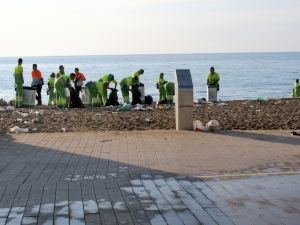 A few of the hundreds of council workers cleaning up after the Barceloneta Beach party.
